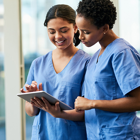 Two nurse practioners talking