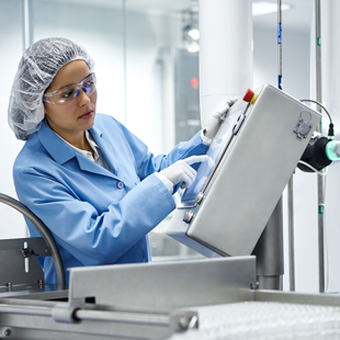 Fresenius Kabi technician operating state-of-the-art manufacturing plant